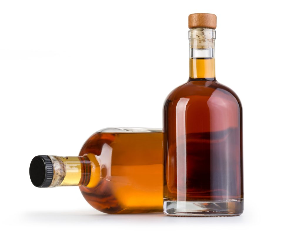Full whiskey bottle isolated